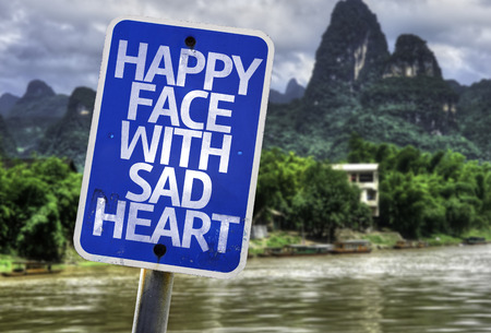 sad heart: Happy face with sad heart sign with wetland background