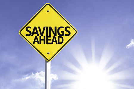 ahead: Savings ahead sign with sunny background