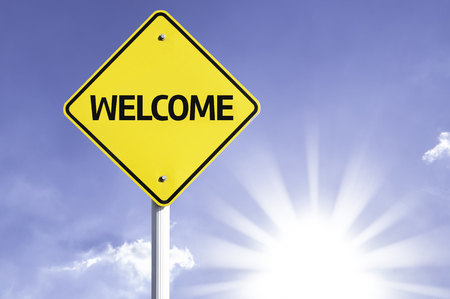 courteous: Welcome sign with sunny background
