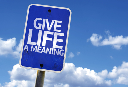 philosophical: Give life a meaning sign with clouds and sky background