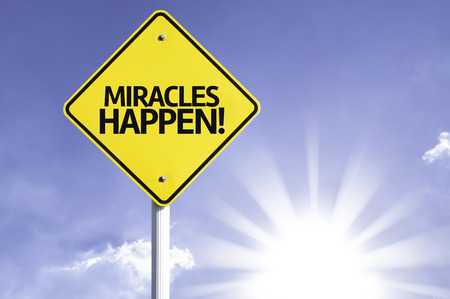 positivism: Miracles happen! sign with sunny background