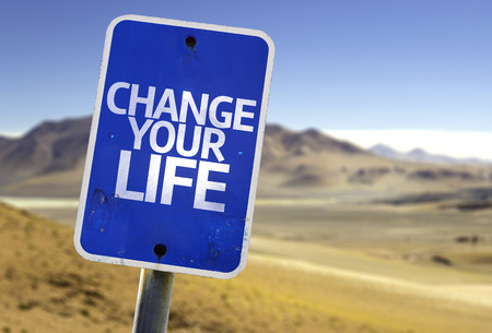 Change your life sign with desert background