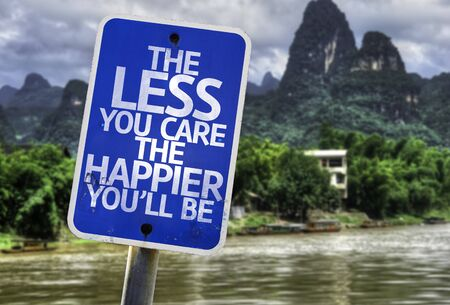 happier: The less you care the happier youll be sign with wetland background