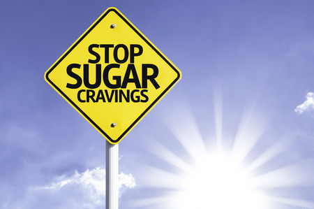 cravings: Stop sugar cravings sign with sunny background