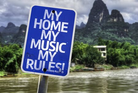 dissatisfaction: My home my music my rules! sign with wetland background