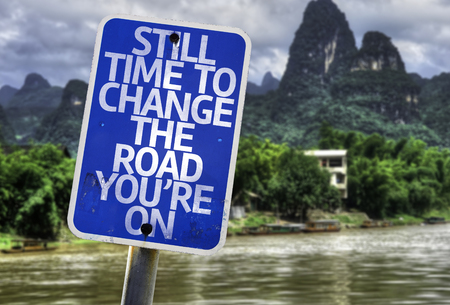 reconstruct: Still time to change the road youre on sign with wetland background Stock Photo