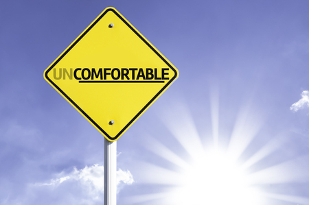 uncomfortable: Uncomfortable sign with sunny background