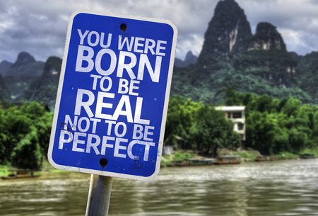 imperfection: You were born to be real not to be perfect sign with wetland background