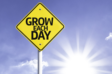 each: Grow each day sign with sunny background