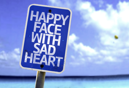 sad heart: Happy face with sad heart sign with sea background Stock Photo