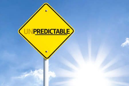 unanticipated: Unpredictable sign with sunny background Stock Photo
