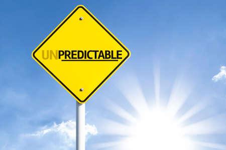 unpredictable: Unpredictable sign with sunny background Stock Photo