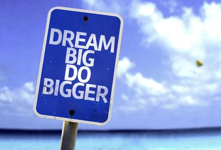bigger: Dream big do bigger sign with sea background