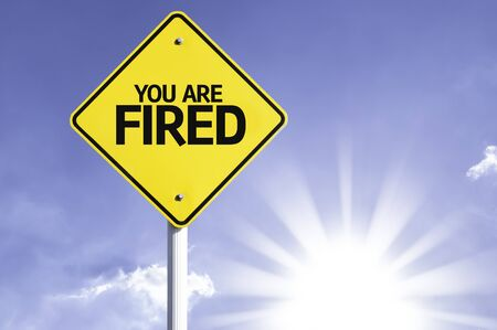 terminated: You are fired sign with sunny background