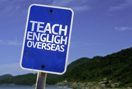 Teach English overseas sign with beach background