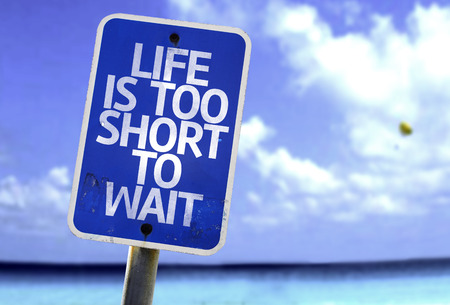 wait sign: Life is too short to wait sign with sea background