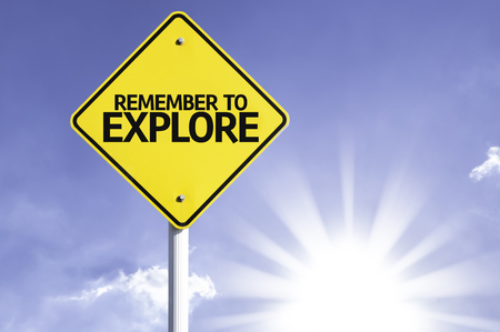 Remember to explore sign with sunny background Stock Photo