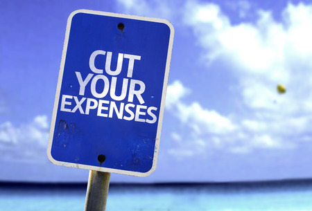expenses: Cut your expenses sign with sea background