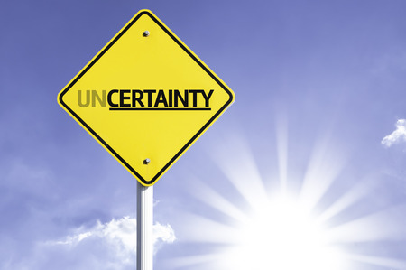 uncertainty: Uncertainty sign with sunny background Stock Photo