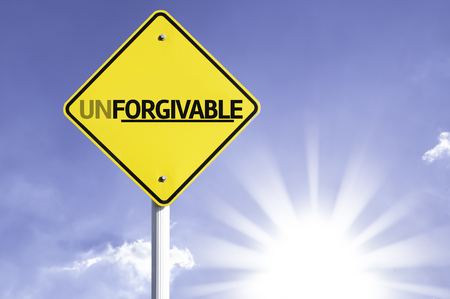 redeeming: Unforgivable sign with sunny background