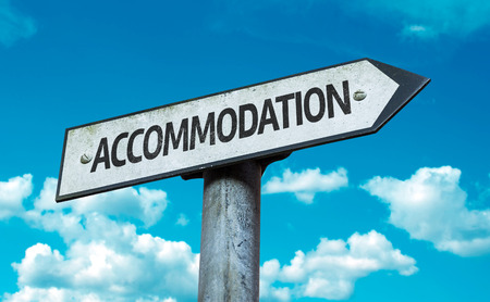 accommodation: Accommodation sign with clouds and sky background