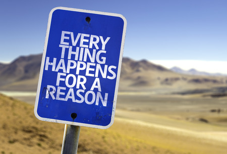 happens: Everything happens for a reason sign with desert background Stock Photo