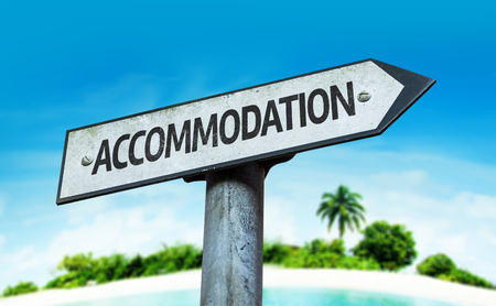 accommodation: Accommodation sign with beach background Stock Photo