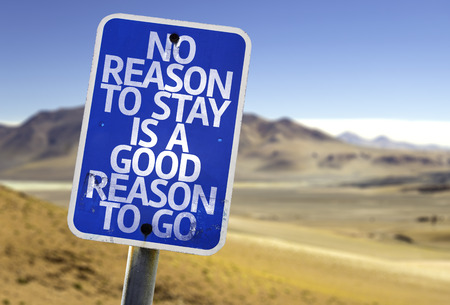 go sign: No reason to stay is a good reason to go sign with desert background Stock Photo
