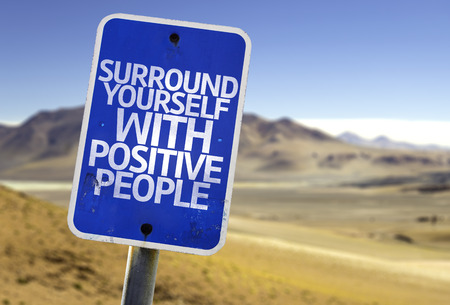 living wisdom: Surround yourself with positive people sign with desert background