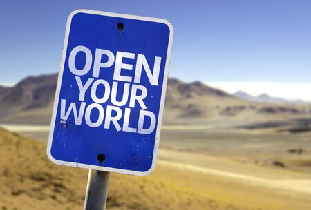 receptive: Open your world sign with desert background Stock Photo