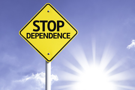 Stop dependence sign with sunny background Stock Photo