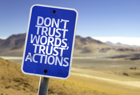 resourcefulness: Dont trust words, trust actions sign with desert background