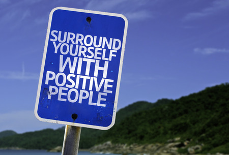 surround: Surround yourself with positive people sign with beach background