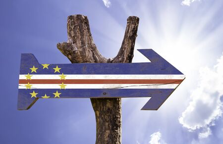 Cape Verde flag sign with arrow on sunny background