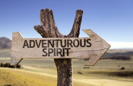 adventurous: Adventurous spirit sign with arrow on desert background