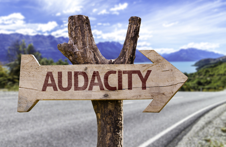audacious: Audacity sign with arrow on road background Stock Photo