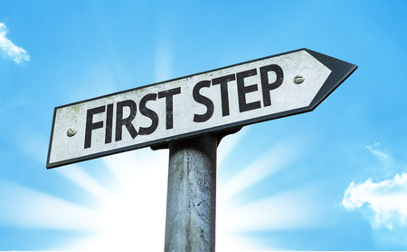 first step: First step sign with sunny background Stock Photo
