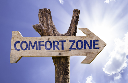 persevere: Comfort zone sign with arrow on sunny background Stock Photo