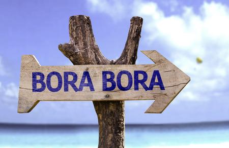 bora: Bora Bora sign with arrow on beach background Stock Photo