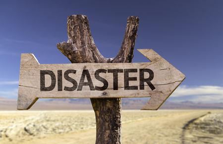 Disaster sign with arrow on desert background