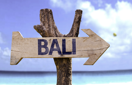 bali province: Bali sign with arrow on beach background Stock Photo