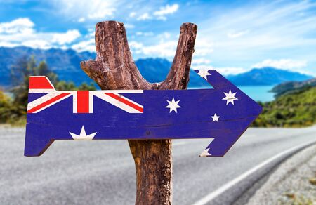 Australia flag sign with arrow on road background