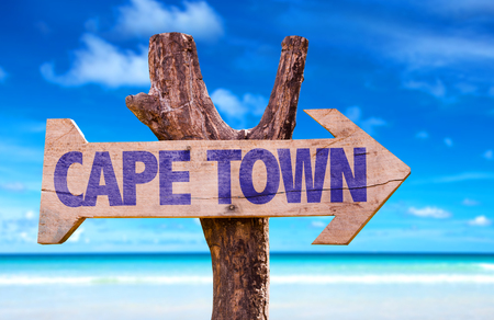 Cape Town sign with arrow on beach background