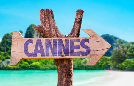 french way: Wooden sign board in wetland with text: Cannes
