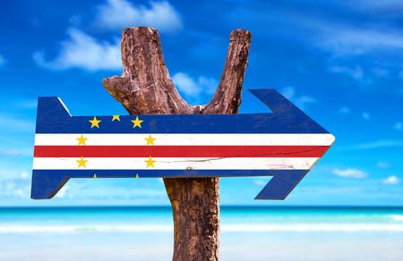 Cape Verde flag sign with arrow on beach background