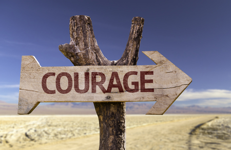 unafraid: Courage sign with arrow on desert background Stock Photo