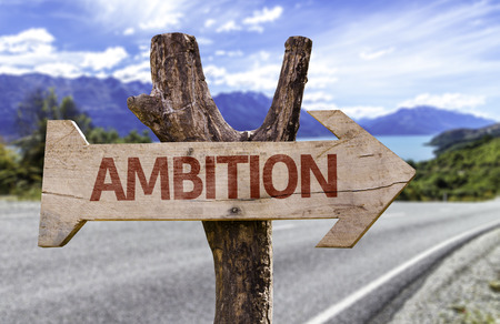 Ambition sign with arrow on road background