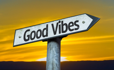 positivism: Good vibes sign with sunset background