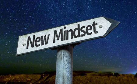 mindset: New mindset sign with night sky background Stock Photo