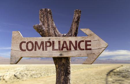 operational: Compliance sign with arrow on desert background